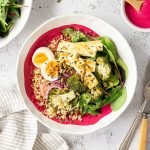 Beetroot bliss bowls with bulghur wheat, roast broccoli, pickled red onion, boiled eggs and haloumi.