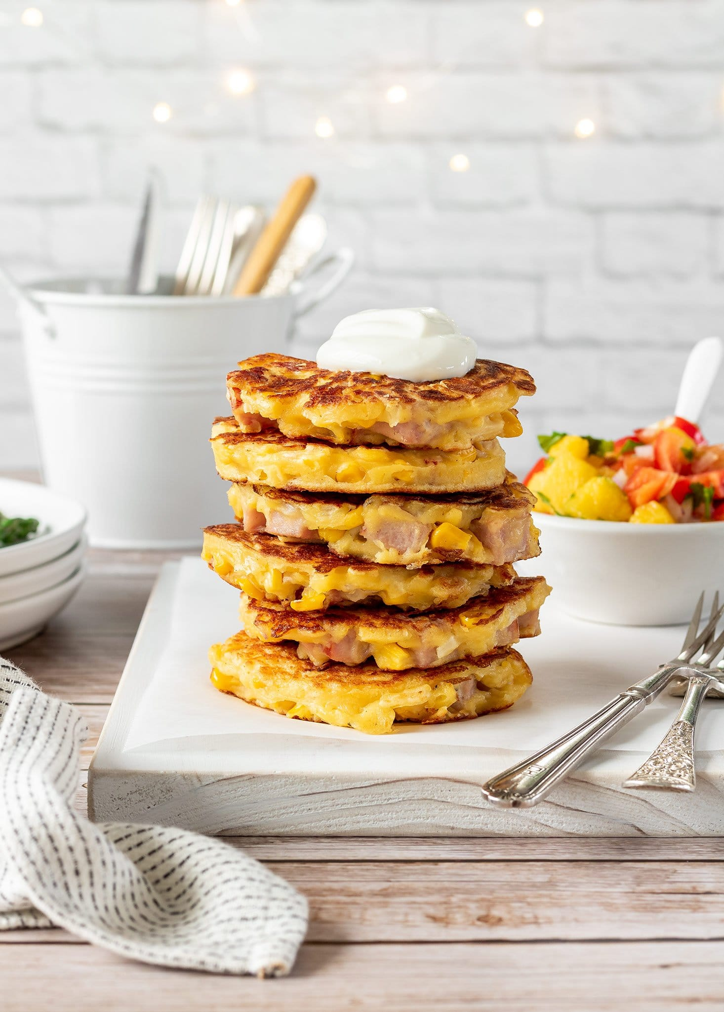 Ham and sweetcorn fritters with mango salsa, Greek yoghurt and asparagus.