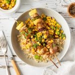Hawaiian chicken skewers with coconut rice, peanut coconut sauce and corn salsa.