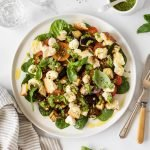 Loaded caprese salad with roasted eggplant, croutons and basil pesto dressing.