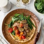 Mediterranean lamb bowls with couscous, roasted tomatoes and dukkah.