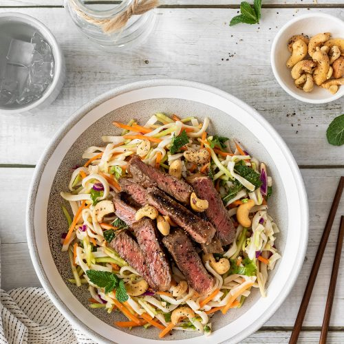 Vietnamese beef salad, featuring noodle slaw, sliced steak and roasted cashews.
