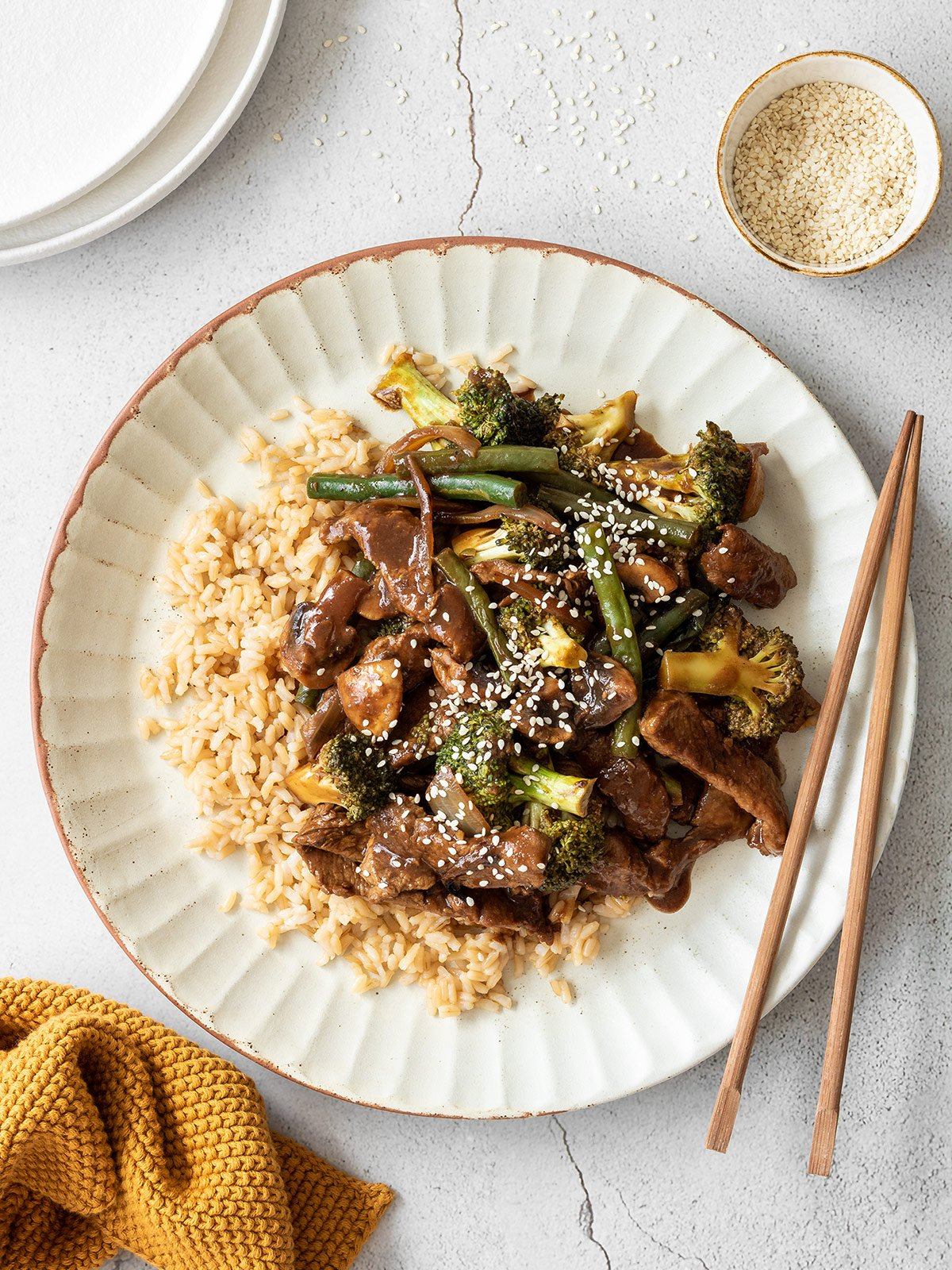 Black bean beef on brown rice with sesame seeds.