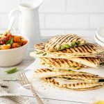 Summery vegetarian quesadillas with cherry tomato salsa and lemon wedges.