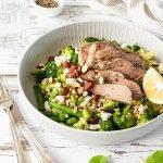 Butterflied lamb salad with pearl barley, greens, feta, almonds and lemon.