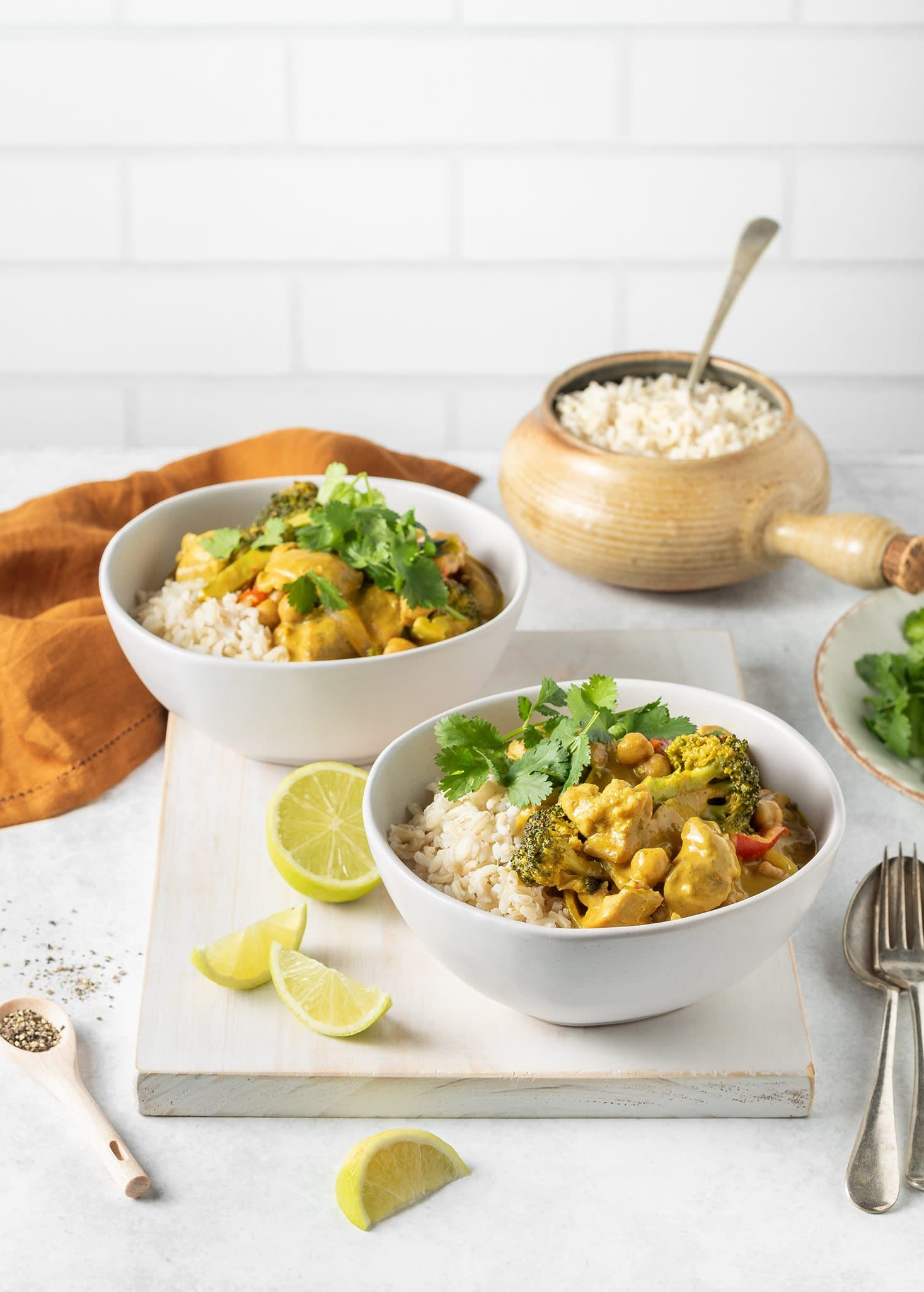 Peanut butter chicken curry on brown rice with lime and coriander.