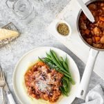 Sausage ragu on creamy mash with green beans and parmesan.
