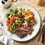 French onion potato bake with steak and salad.