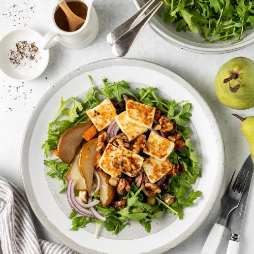 Maple roasted pear salad with rocket, red onion, haloumi and walnuts.
