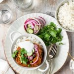 Sausage korma curry with basmati rice and quick pickled veggies.
